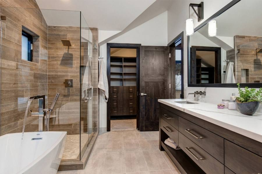 bathroom with dark cabinets