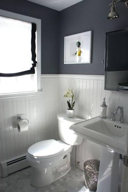 Small bathroom idea with coral stone veneer on the wall [Design: Gary J Ahern