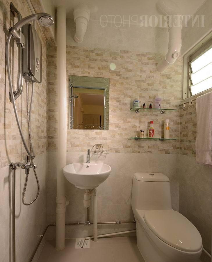 Opt for a curved shower enclosure in this instance as it takes up less room compared to an angled one