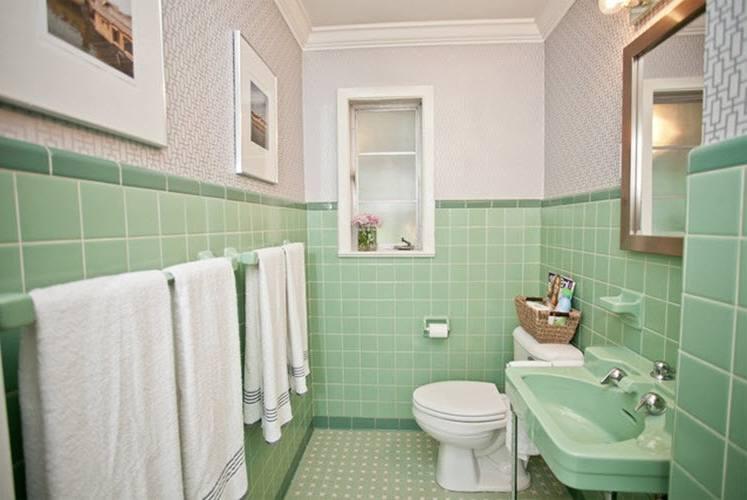 various green subway tile bathroom