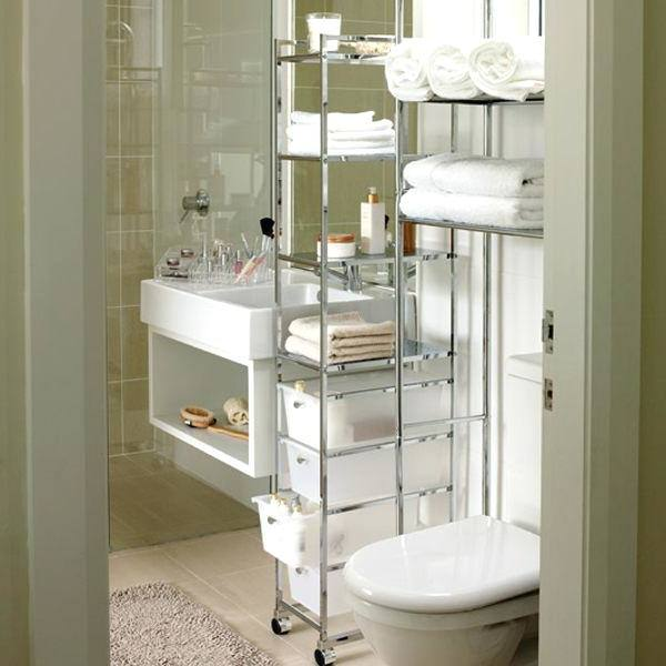 Bright, light family bathroom with bathroom ladder storage unit, towels and bathroom accessories
