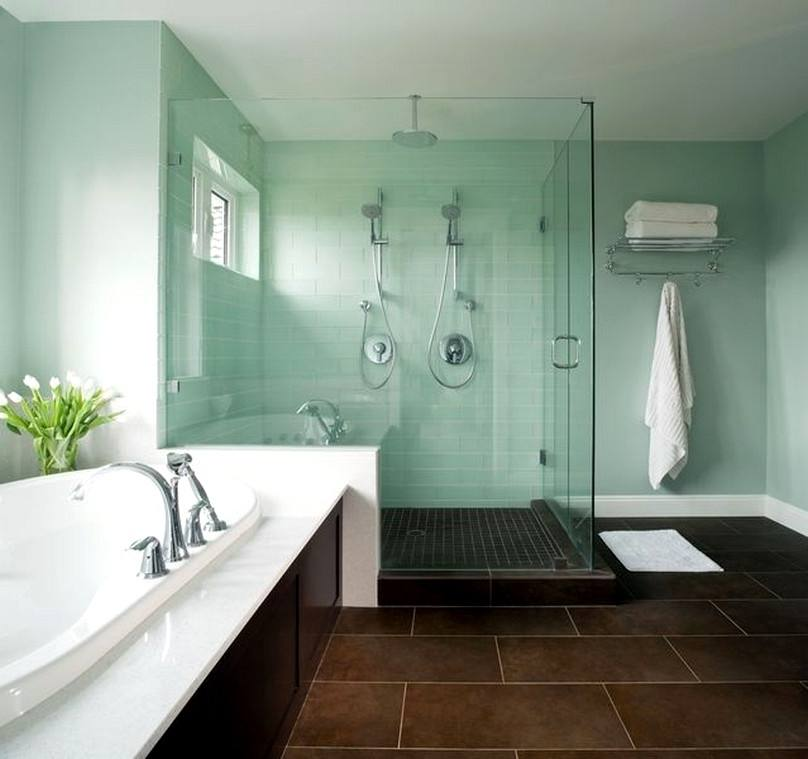 Fancy Decorating Ideas For Modern Bathroom With Glass Shower Enclosure Plus White Shower Pan Also Small Rug On The Brown Wood Laminate Floor Plus Wooden
