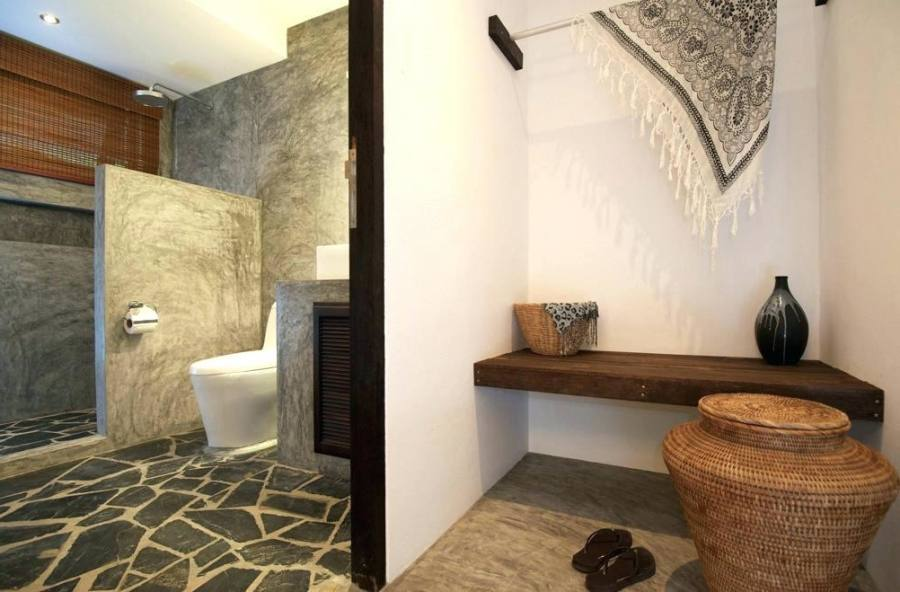 Natural stone wall for the cabin style rustic bathroom [Design: Traditional Log Homes Ltd