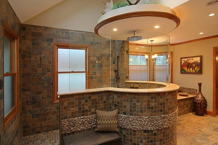 Bathroom stone wall and tile around the tub i'd probably take baths in this tub! Just make the stone wall a waterfall wall