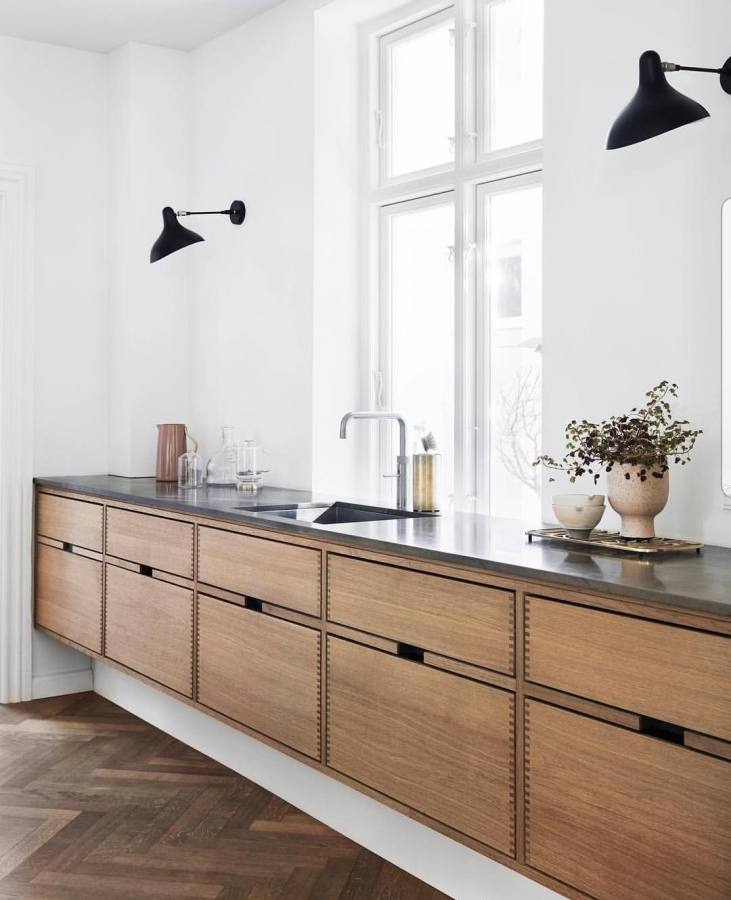 The cabinets were designed by Danish architect Knud Knapper after studying