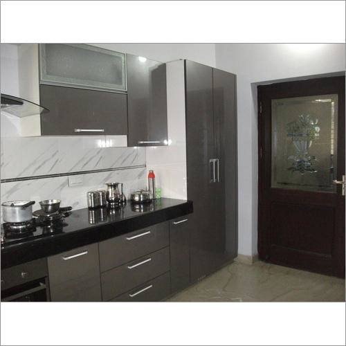 Acrylic kitchen cabinets with melamine accents by Kitchen Craft Cabinetry