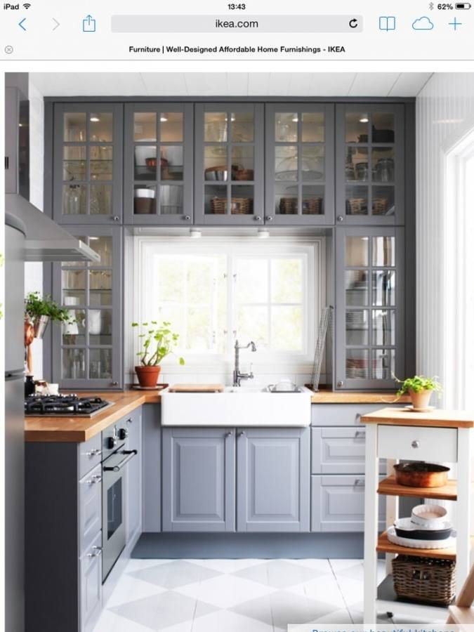 Small black and white kitchen with chalk doors inscribed with messages