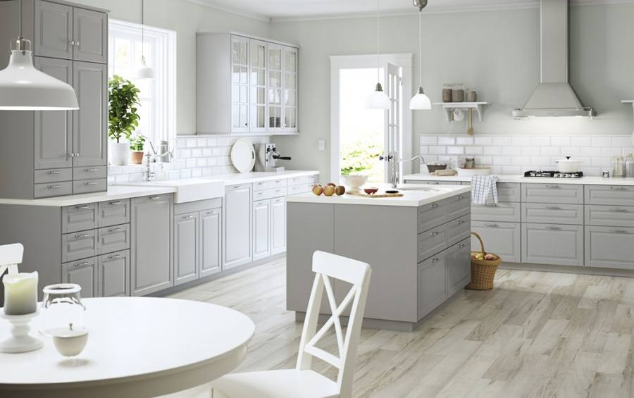 A white kitchen with green accents