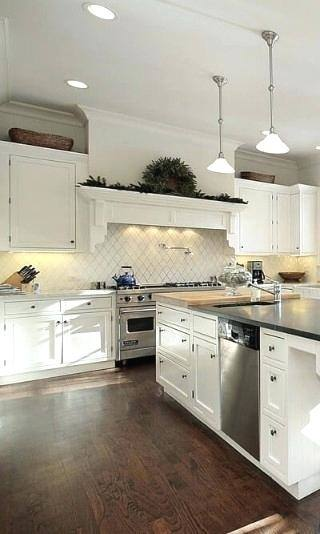Off white cabinets in casual kitchen by Kitchen Craft Cabinetry · KateFales2
