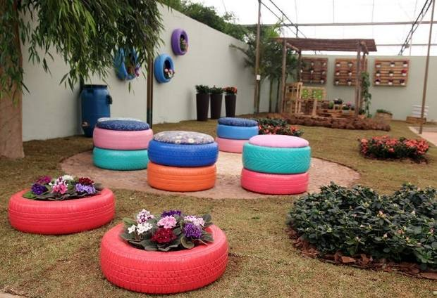Brightly painted tire planters edge a fine crushed stone pathway at Kiddie Kollege, Statesville, NC