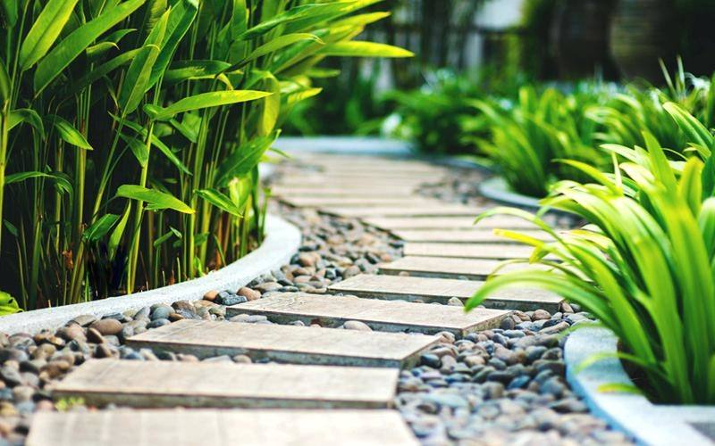 If you have an area of the garden where grass is struggling to grow, you may want to consider utilising decorative stones to hide the area, but in a minimal