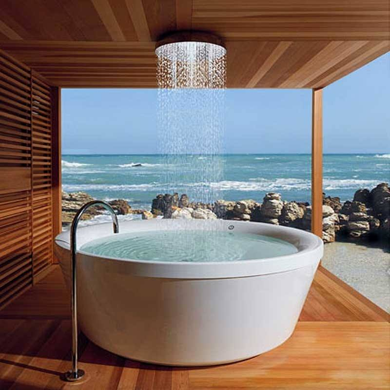 Enveloped by verdant vines, ferns and plants, the outdoor showers in the beachfront suites