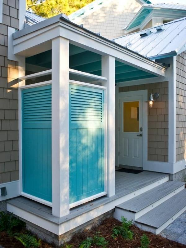 Beach house with outdoor shower with shingles,