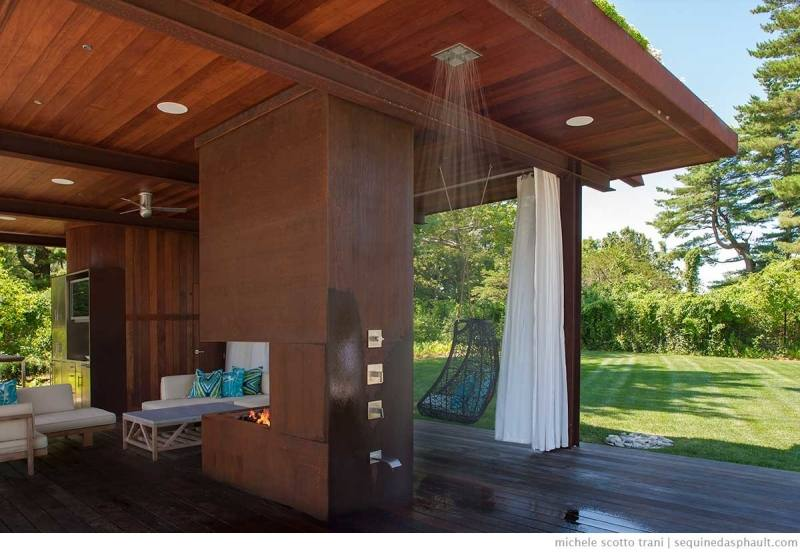 This beach house went with a surf theme for their outdoor shower
