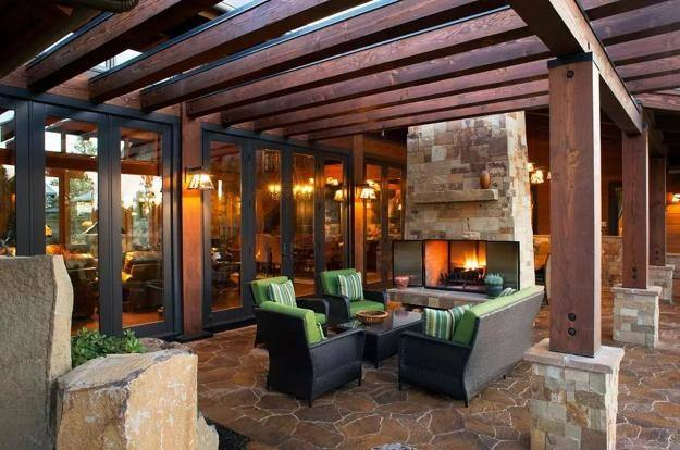 outdoor living room in walnut bend area spaces with pool and fireplace