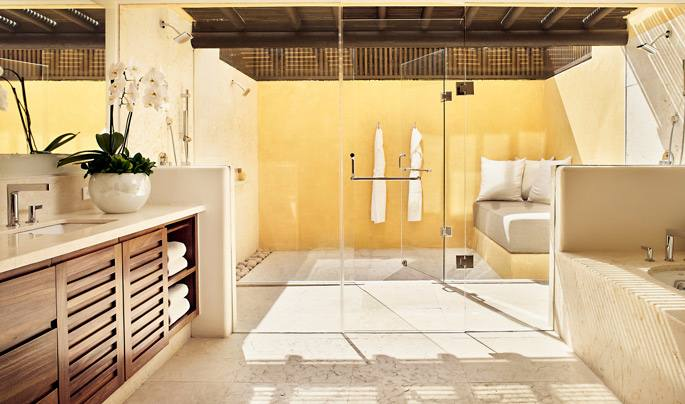 The Deluxe Private Garden Rooms and Suites have outdoor sculpted tubs and showers