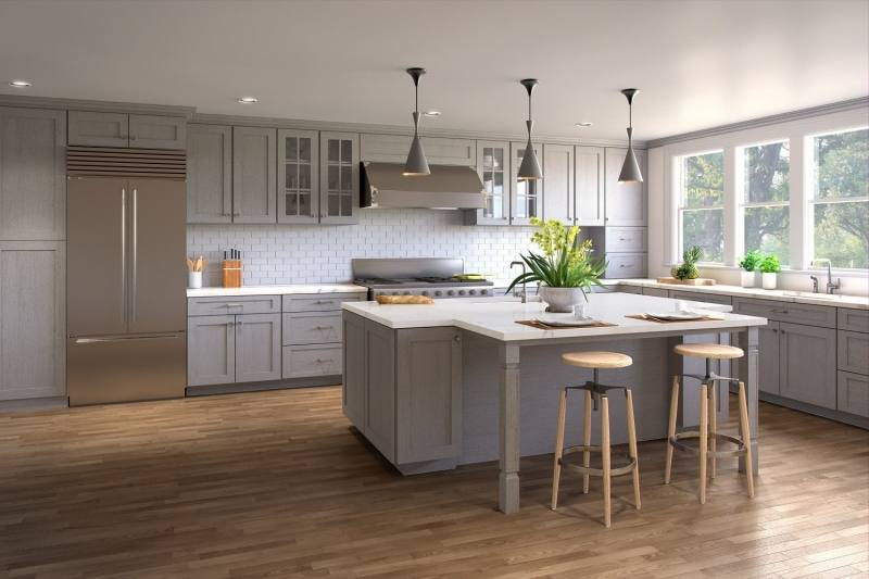 Gray and white kitchen features a white kitchen island topped with a white  marble countertop seating a backless iron bar stool and completed with a  sliding