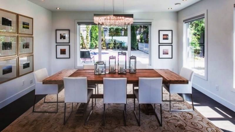 The bold art pieces make great dining room wall decor ideas and bring a  nice focal point to the room