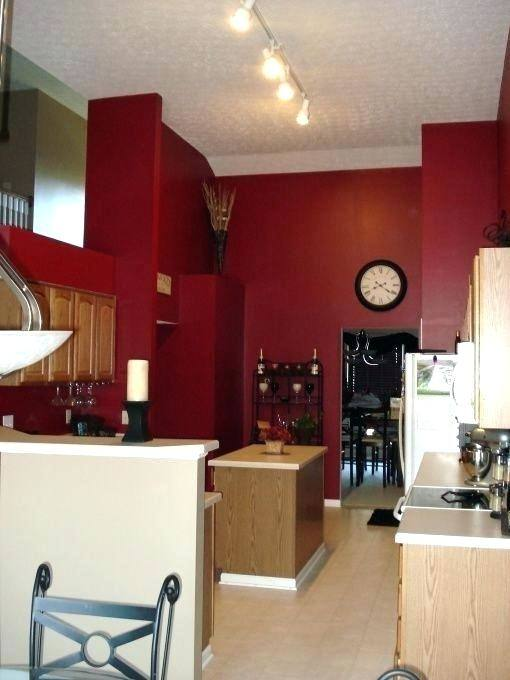love the black white tile and red walls very dramatic barn kitchen cabinets ideas