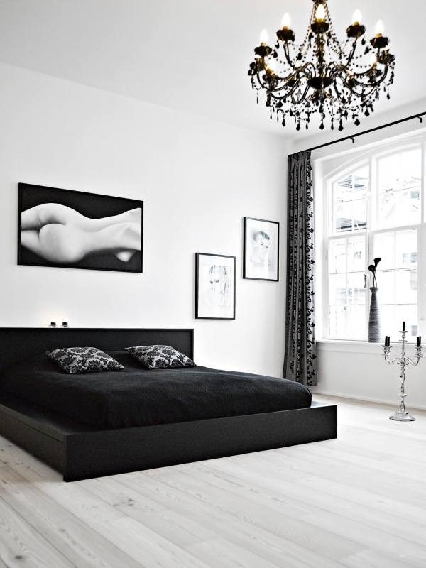 Give your bedroom a modern glam feel by decorating with a black and white color scheme