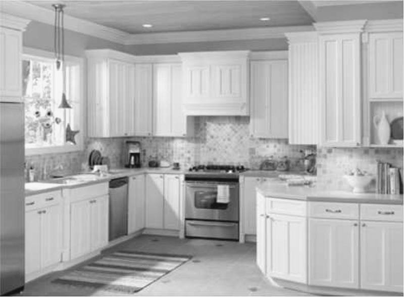 Dark floors,white cabinets, white granite, silver knobs and gray paint wall