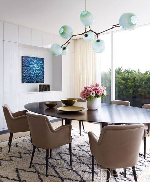 Colorful artwork stands out in this modern dining area