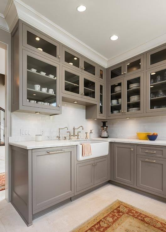Choosing  the right wall paint color with dark wood cabinets can make a big  difference in