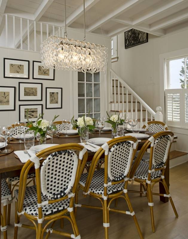 Antique Dining Round Golden Polished Chandelier Over Black Oval Dining Table And White Tufted Backseat Upholstered Dining Chairs In European Dining Room