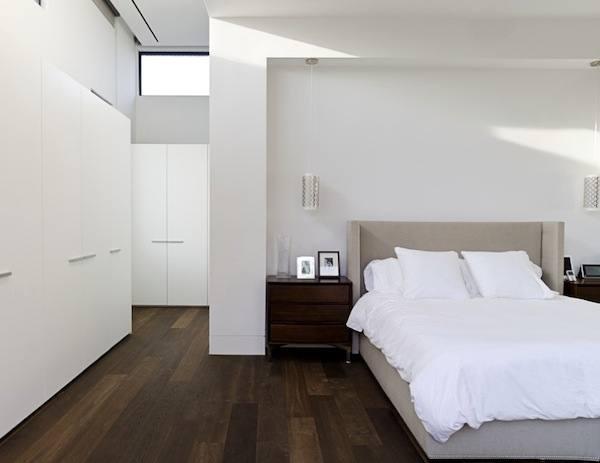 light blue walls dark wood floor white raised panel kitchen cabinet