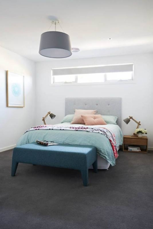 Aqua blue accent wall and love seat