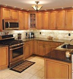 Marvelous Light Caramel Rope Kitchen Cabinets With Black Granite Countertop  Combined With White Subway Tile Backsplash And Simple Pendant Lamps For  Best