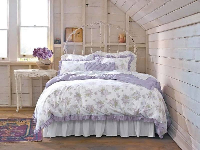 Wire pendant lights, bright accent pillows and colorful bedding shape  the shabby chic bedroom [