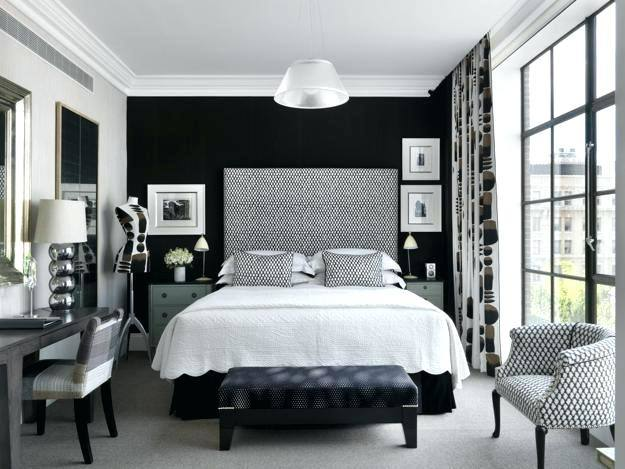 Pair a bold black headboard and black decor with white walls to add lightness to your black bedroom